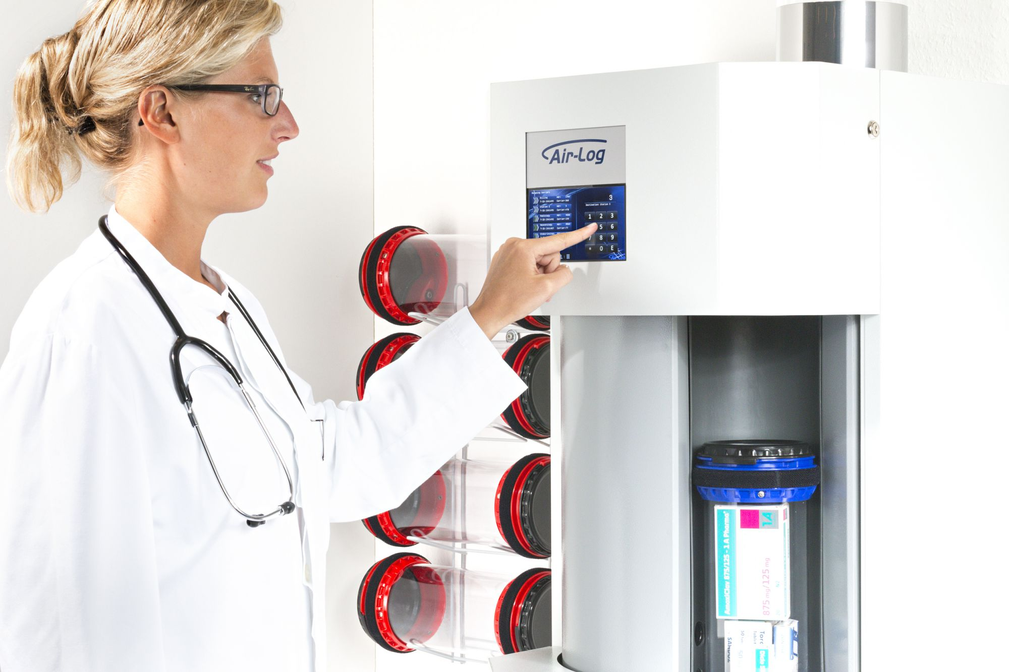 Doctor uses front-load-station. Pneumatic tube systems in hospitals.